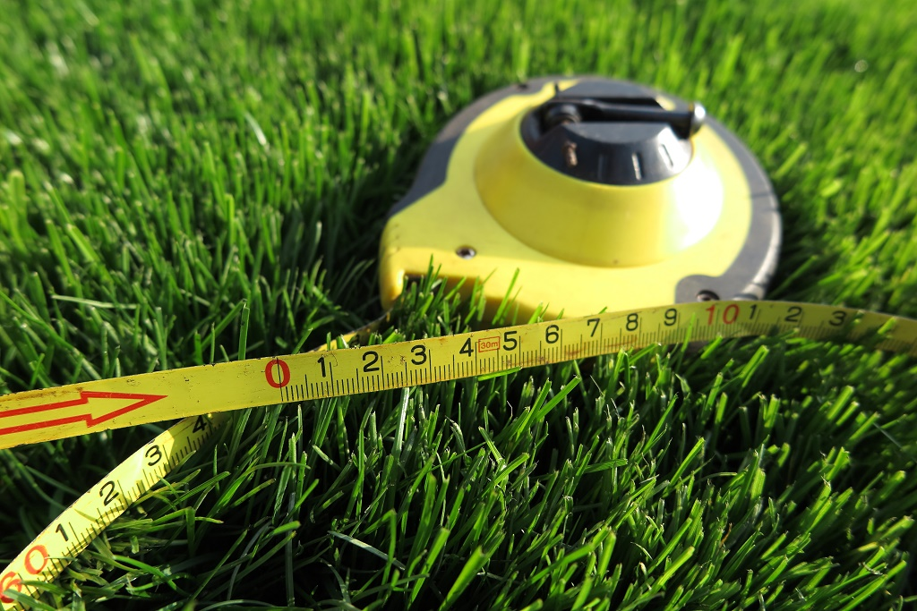 a measure tape on grass