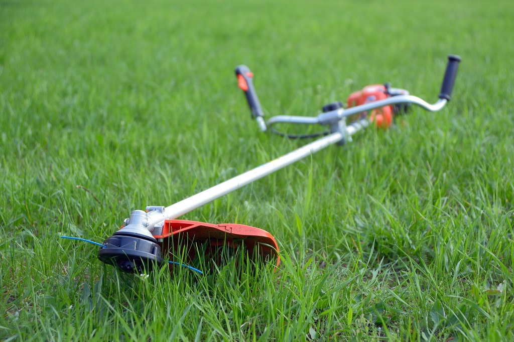a weed eater on grass