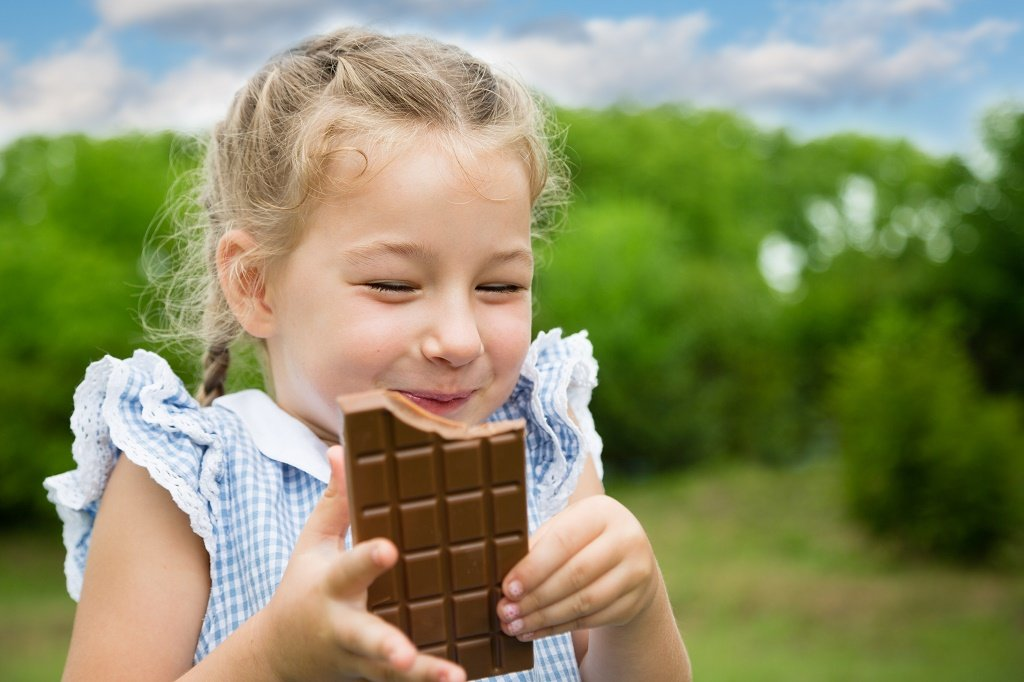 little girl and chococlate bar