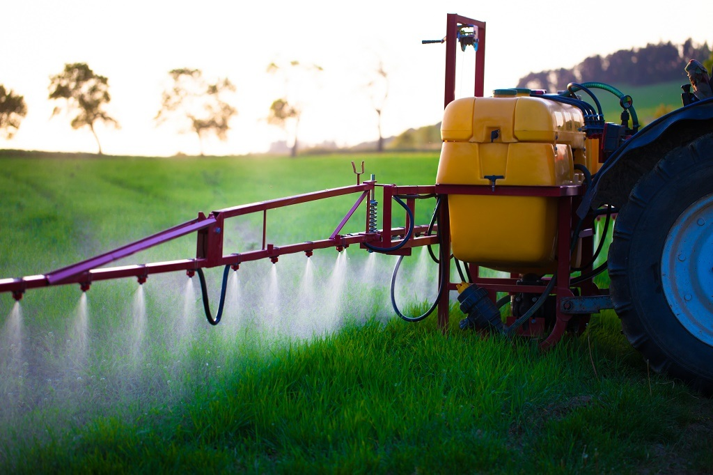 spraying tractor in action