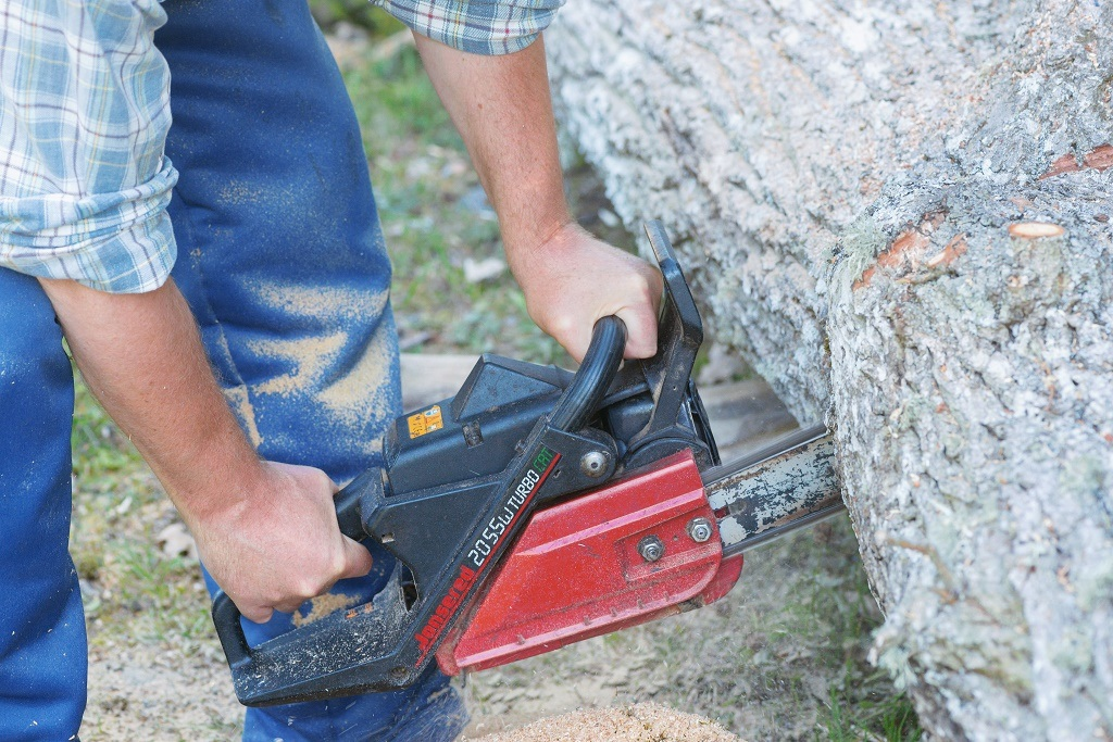Using a Jonsered chainsaw