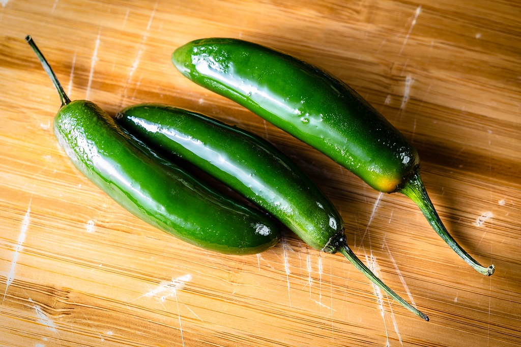 serrano peppers on a chopping board