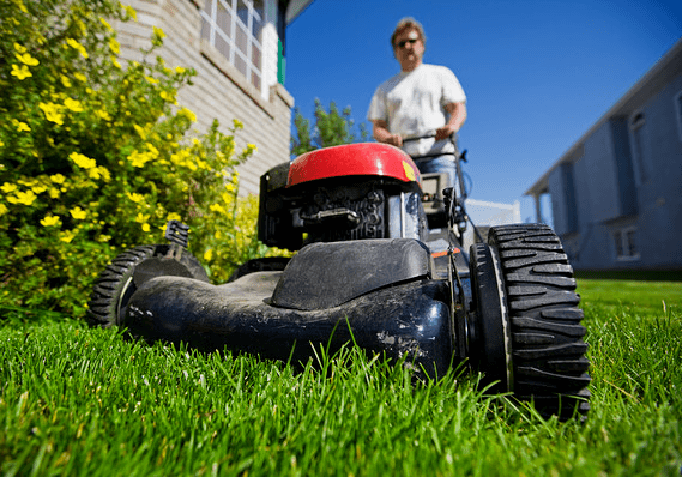 man and lawn mower