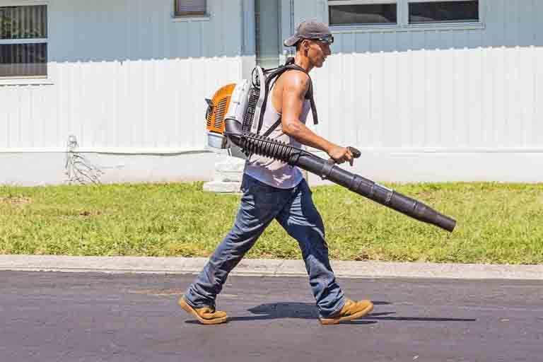 Man with leaf blower outside